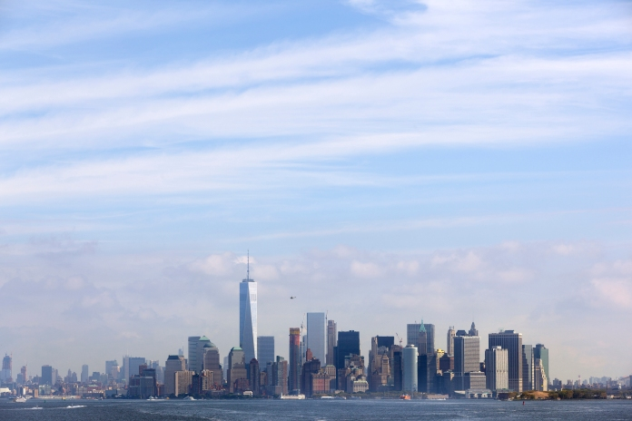lower manhattan skyline with blue sky and clouds
